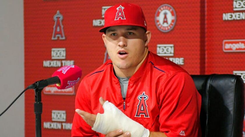 The Angels' Mike Trout speaks about his injured left thumb during a news conference June 3. Trout will miss the All-Star game while rehabilitating a torn thumb ligament.