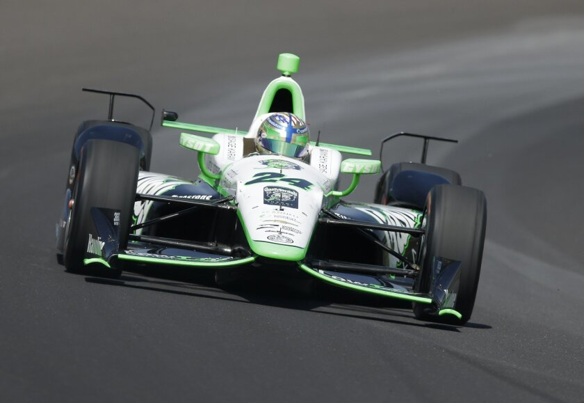 Sage Karam drives through turn one during the final practice session for the Indianapolis 500 auto race at Indianapolis Motor Speedway in Indianapolis, Friday, May 27, 2016. (AP Photo/Michael Conroy)