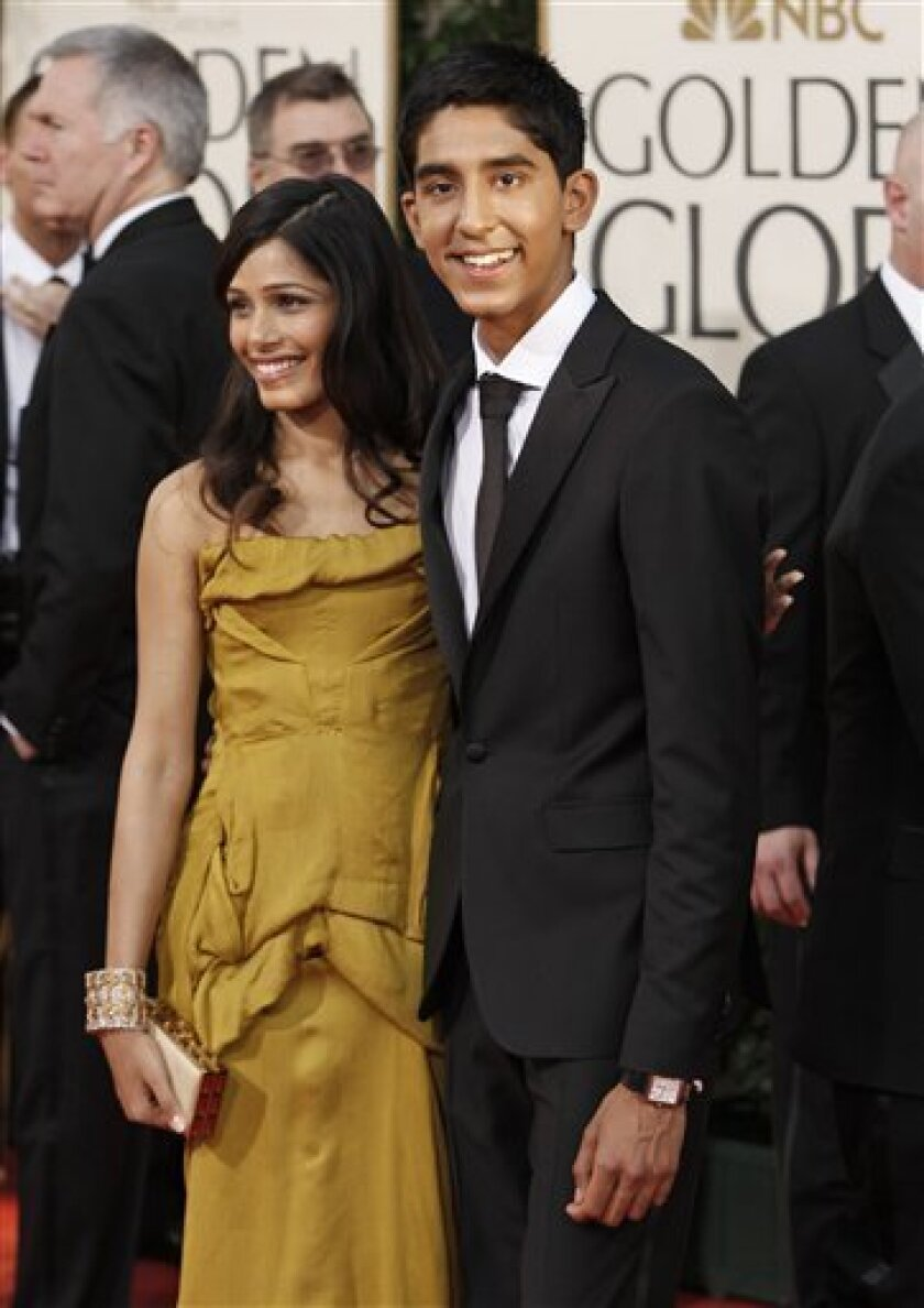 Freida Pinto, left, and Dev Patel, of the film �Slumdog Millionaire,� pose as they arrive at the 66th Annual Golden Globe Awards on Sunday, Jan. 11, 2009, in Beverly Hills, Calif. (AP Photo/Matt Sayles)