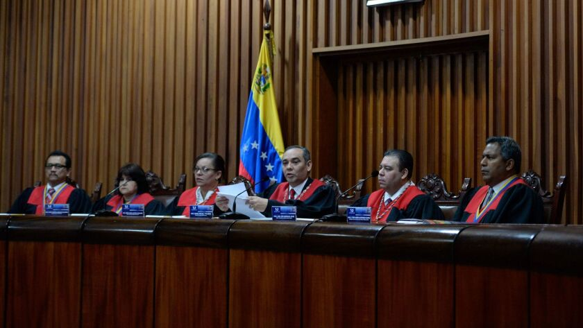 Venezuela's Supreme Court President Maikel Moreno (3rd R) speaks during a press conference at the Su