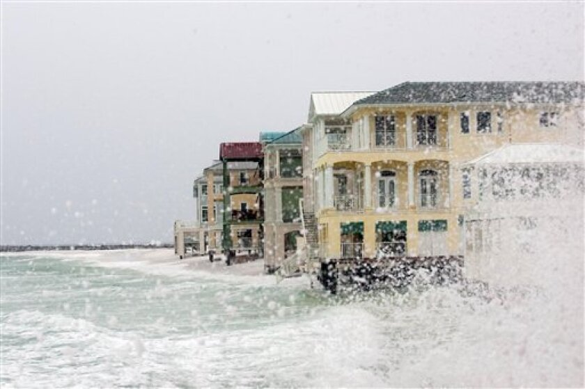 The Gulf of Mexico slams against homes prior to Tropical Storm Ida in Destin, Fla. on Monday Nov. 9, 2009. (AP Photo/Mari Darr~Welch)