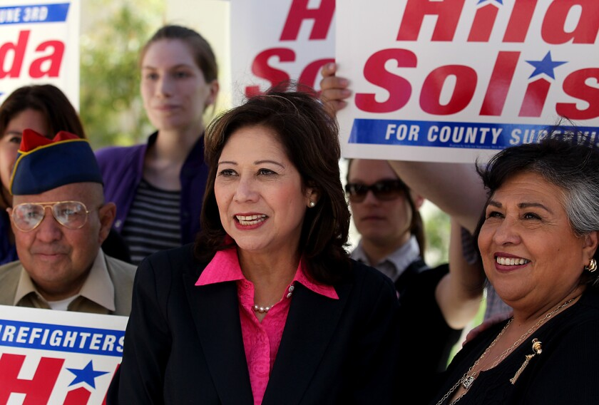 L.A. County Supervisorial candidate Hilda Solis, center, is joined by supporters after getting the endorsement of current Supervisor Gloria Molina, right, during a press conference.