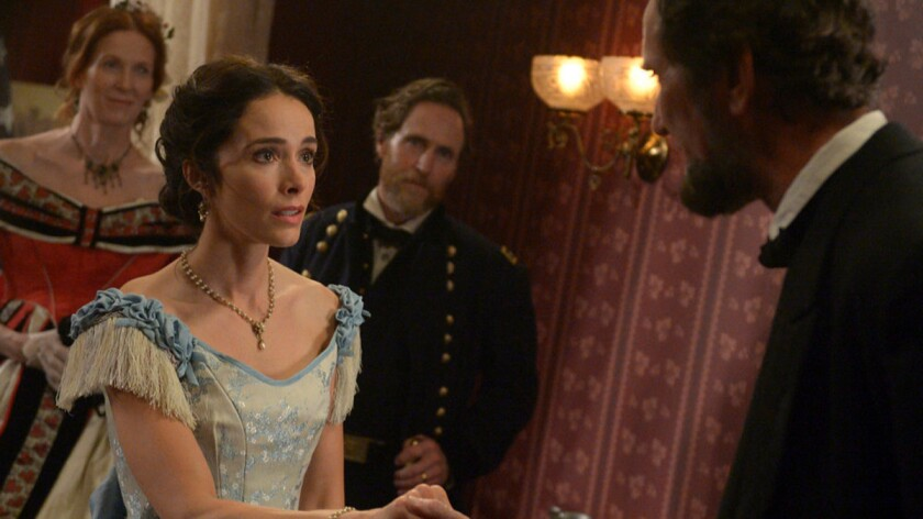 """Time traveler and historian Lucy (Abigail Spencer) meets her favorite president in an upcoming episode of """"Timeless."""""""