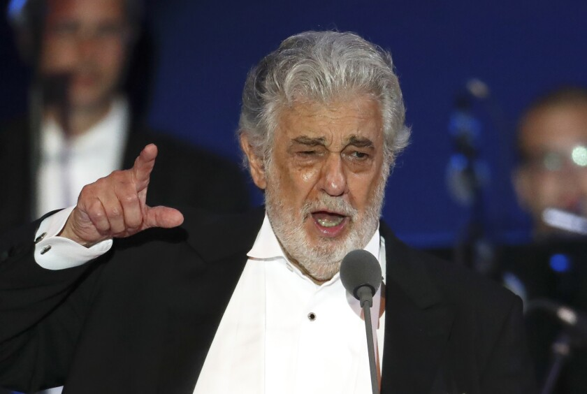 FILE - In this Aug. 28, 2019, file photo, opera singer Placido Domingo performs during a concert in Szeged, Hungary. Domingo is back in Europe to receive a lifetime achievement award after recovering from the coronavirus, vowing in an interview with a top Italian daily newspaper to clear his name from allegations of sexual misconduct. The opera legend's appearance Thursday, Aug. 6, 2020, to accept the award from the Austria Music Theater will be his first in public since recovering from the virus at his home in Acapulco, Mexico. (AP Photo/Laszlo Balogh, File)