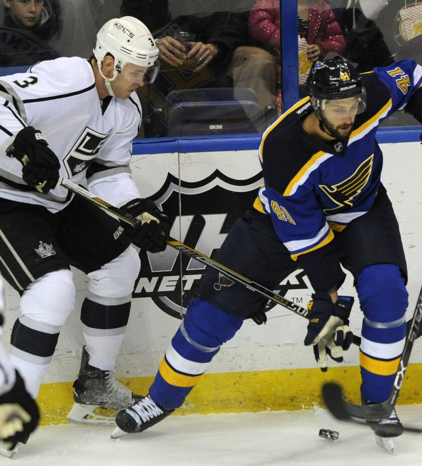 St. Louis Blues' Robert Bortuzzo (41) battles for the puck with Los Angeles Kings' Brayden McNabb (3) during the first period of an NHL hockey game, Thursday, Feb. 18, 2016, in St. Louis. (AP Photo/Bill Boyce)