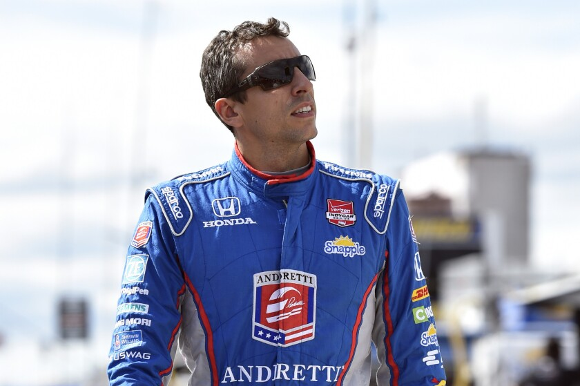 Justin Wilson of England died Monday after suffering a head injury during an IndyCar race Sunday at Pocono Raceway. He was 37.