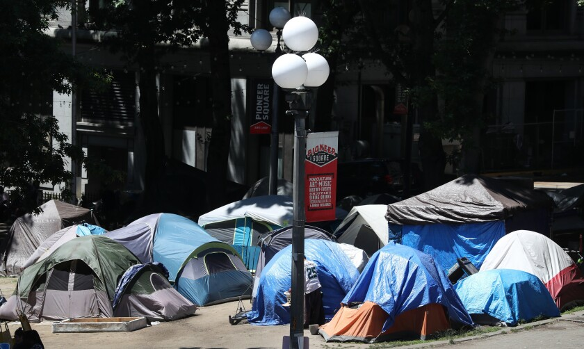 King County Council member Reagan Dunn has proposed legislation seeking to have the homeless encampment at City Hall Park, seen Tuesday, June 22, 2021, south of the King County Courthouse in Seattle, condemned as a public safety hazard. (Ken Lambert/The Seattle Times via AP)