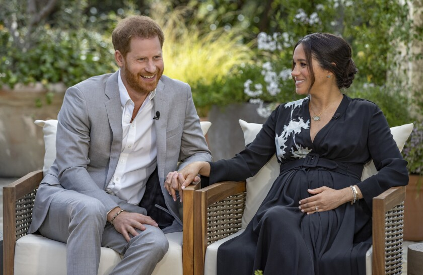 Prince Harry and Meghan, Duchess of Sussex, hold hands and tell Oprah Winfrey their second child is a girl.