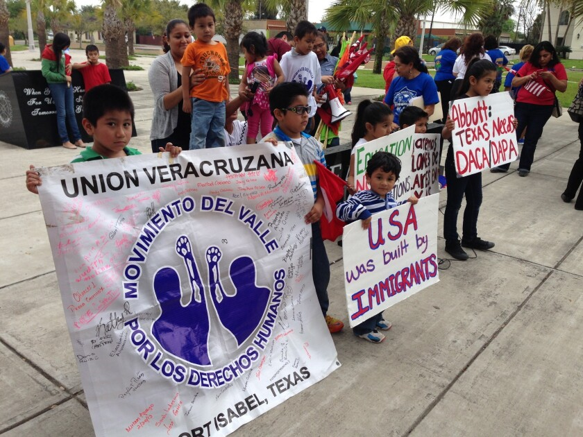 Immigration activists gather Thursday outside a federal courthouse in Brownsville, Texas, for a hearing on President Obama's immigration plan.