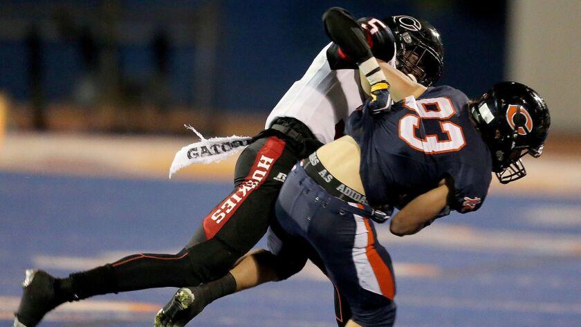 WEST HILLS, CALIF. - NOV. 18, 2016. Centennial defensive back Isaiah Young brings down Chaminade's O