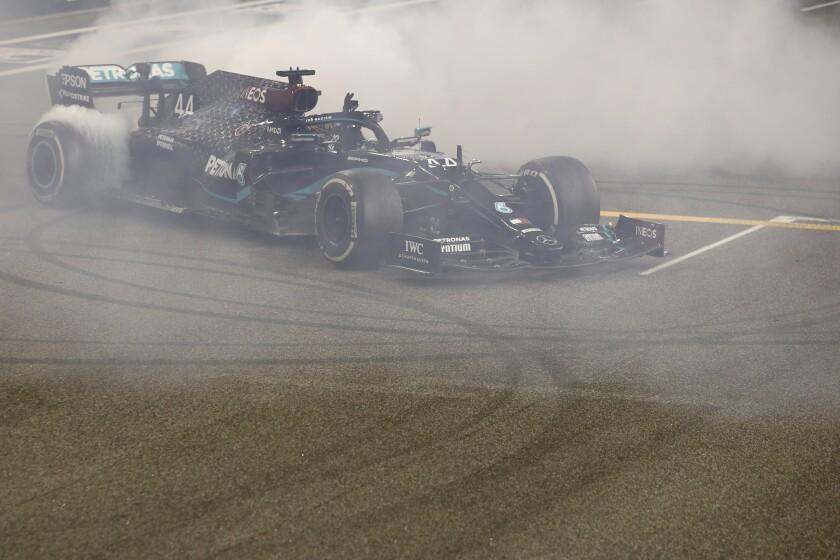 Mercedes driver Lewis Hamilton of Britain burns tires after the Formula One Abu Dhabi Grand Prix in Abu Dhabi, United Arab Emirates, Sunday, Dec. 13, 2020. (Hamad Mohammed, Pool via AP)