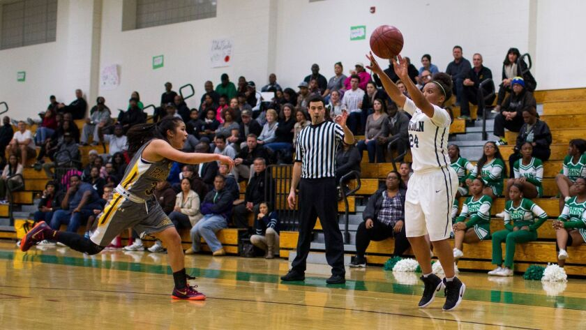 Lincoln's Imani James shoots for three.