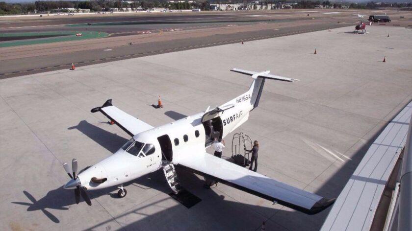 A Surf Air plane parked at McClellan-Palomar Airport in Carlsbad, Calif., is shown. Surf Air has acquired a Texas competitor, Rise.