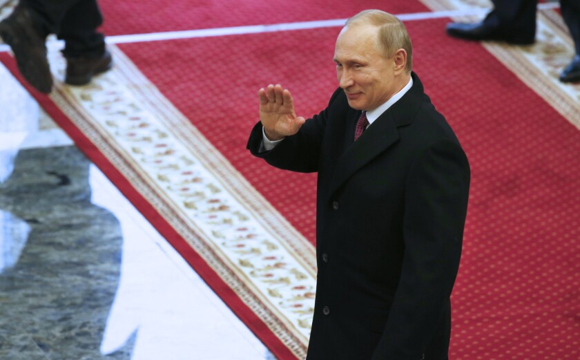 Russian President Vladimir Putin leaves peace talks in Minsk, Belarus, on Feb. 12.