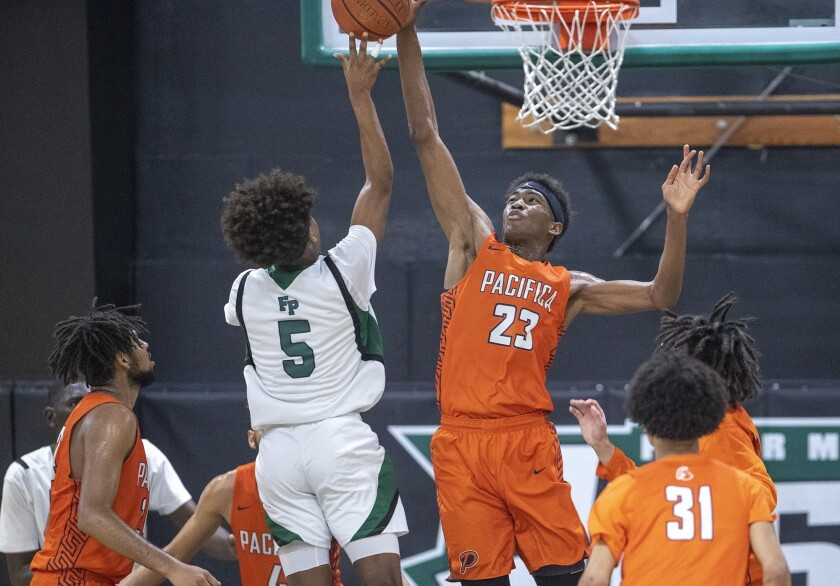 Pacifica Christian Orange County's Judah Brown attempts to block a shot by Fairmont Prep's Atin Wrig