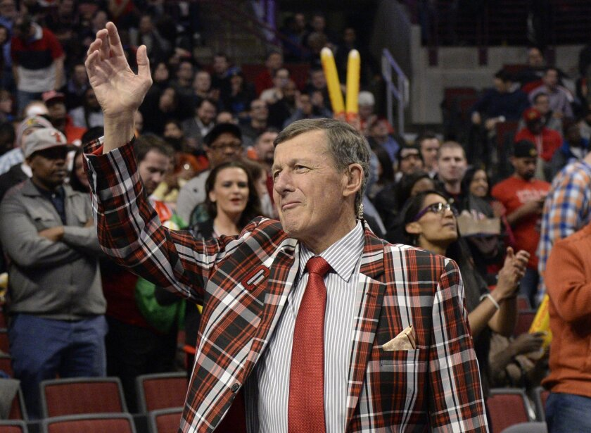 FILE - In this March 5, 2015, file photo, Craig Sager acknowledges the crowd during a timeout in an NBA basketball game between the Chicago Bulls and the Oklahoma City Thunder in Chicago. Sager, the TNT sideline reporter known for wearing flashy suits, missed the NBA's annual midseason gala last ye