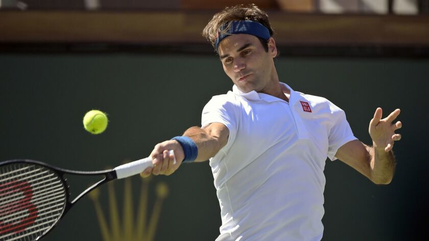 Roger Federer returns a shot during a 6-4, 6-4 victory over Hubert Hurkacz on Friday in a quarterfinal match of the BNP Paribas Open at Indian Wells.