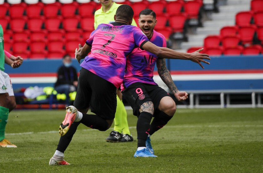 PSG's Kylian Mbappe celebrates with teammate Mauro Icardi, right, after scoring his team's second goal during the French League One soccer match between Paris Saint-Germain and St Etienne at Parc Des Princes in Paris, France, Sunday, April 18, 2021. (AP Photo/Francois Mori)