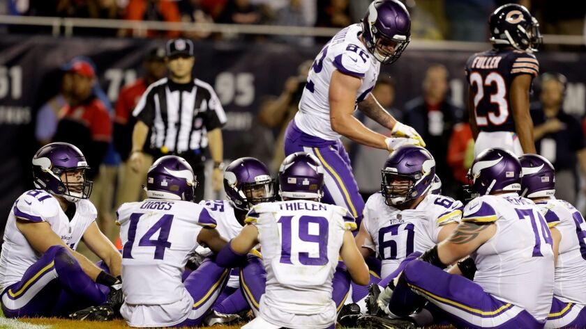 """Minnesota Vikings tight end Kyle Rudolph (standing) celebrates a touchdown with his teammates with a game of """"Duck, Duck, Goose"""" in the end zone."""