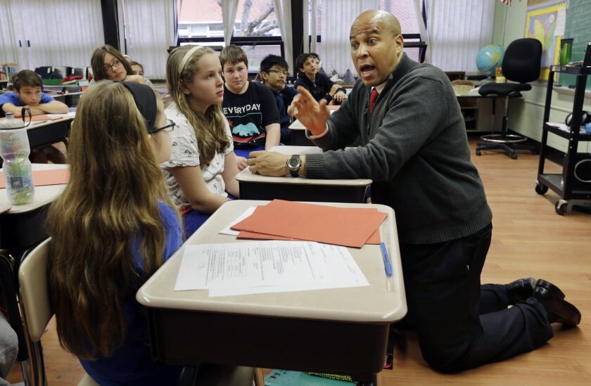 "FILE - In this Nov. 5, 2014, file photograph, U.S. Sen. Cory Booker answers a question from students as he visits his childhood school, Harrington Park School, in Harrington Park, N.J. In his first book, ""United,"" Booker traces his political rise from a councilman in Newark to the mayor to the U.S."