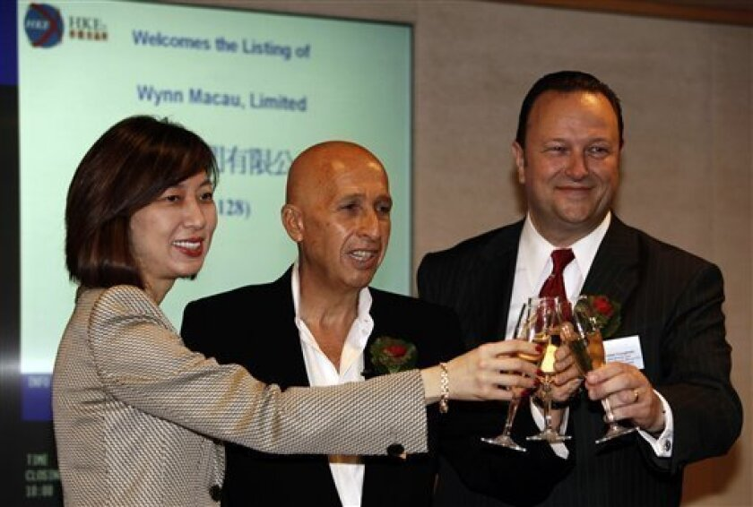From left, Linda Chen, chief operating officer and executive director of Wynn Macau, Limited, Ian Michael Coughlan, executive director and president of Wynn Resorts (Macau) S.A. Wynn Macau, Limited, and Allan Zeman, non-executive director Wynn Macau, Limited attend the listing ceremony of Wynn Macau, Limited at the Hong Kong Stock Exchange Friday, Oct. 9, 2009. Billionaire Steven Wynn saw shares of his Macau casino company jump 13 percent in their trading debut on the Hong Kong stock exchange Friday, reflecting stronger faith in the Chinese gambling city's prospects. (AP Photo/Kin Cheung)