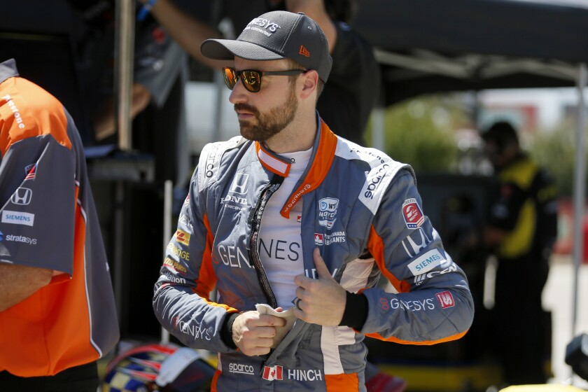 FILE- In this June 6, 2020, file photo, James Hinchcliffe prepares for practice at the IndyCar auto race at Texas Motor Speedway in Fort Worth, Texas. Hinchcliffe will return to Andretti Autosport for the final three races of the season to fill the seat left vacant when Zach Veach stepped out of the car earlier this week, Andretti Autosport announced Friday, Sept. 25, 2020. (AP Photo/Tony Gutierrez, File)