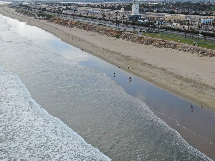 The Huntington Beach department of Marine Safety said they have seen a significant decrease in surfers and people in the water. Pictured is Huntington City Beach during its busiest hours around 3 to 4 p.m. on Wednesday.