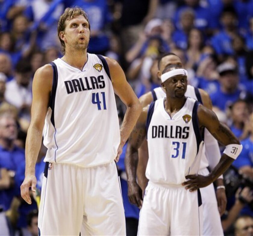 Dallas Mavericks' Dirk Nowitzki (41) and Jason Terry (31) react in the final seconds of the second half of Game 3 of the NBA Finals basketball game against the Miami Heat Sunday, June 5, 2011, in Dallas. (AP Photo/Mark Humphrey)