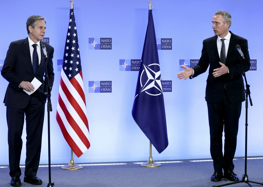 NATO Secretary General Jens Stoltenberg, right, and United States Secretary of State Antony Blinken address a media conference at NATO headquarters in Brussels, Wednesday, April 14, 2021. United States Secretary of State Antony Blinken is in Brussels on Wednesday for talks with European and NATO allies about Afghanistan, Ukraine and other matters. (Kenzo Tribouillard, Pool via AP)