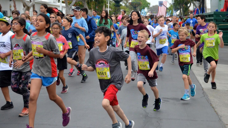 The open heat 9 & up race kicked off the OC Marathon Kids Run Saturday at the OC Fair & Event Center in Costa Mesa.