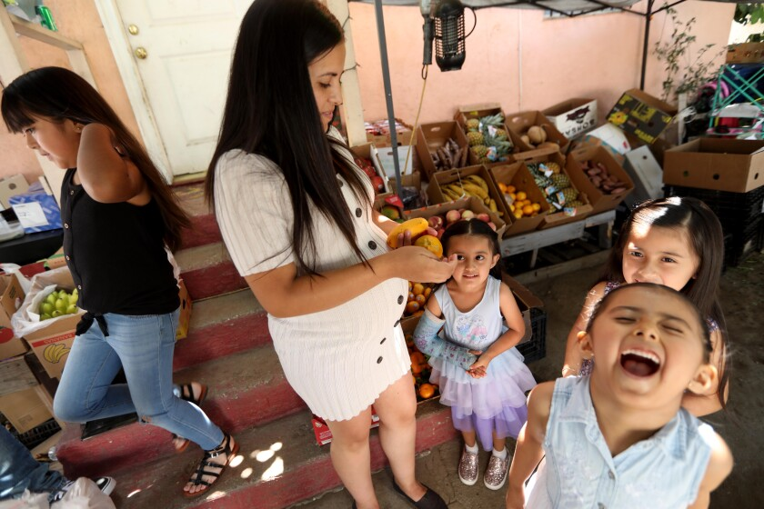 Maria Reyes, second from left, spends time with daughters Marilyn, left, Darlene, Sophia and Leilani near their home in L.A.