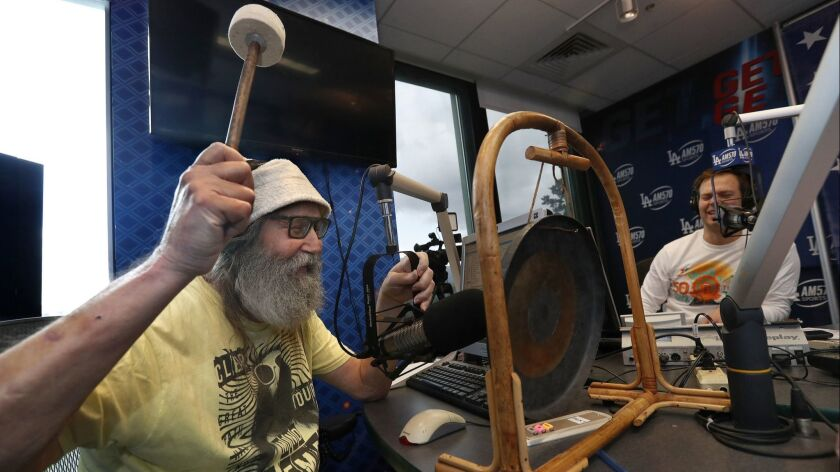 """BURBANK, CA-NOVEMBER 29, 2018: Radio sports announcer Vic """"The Brick"""" Jacobs strikes the gong while"""