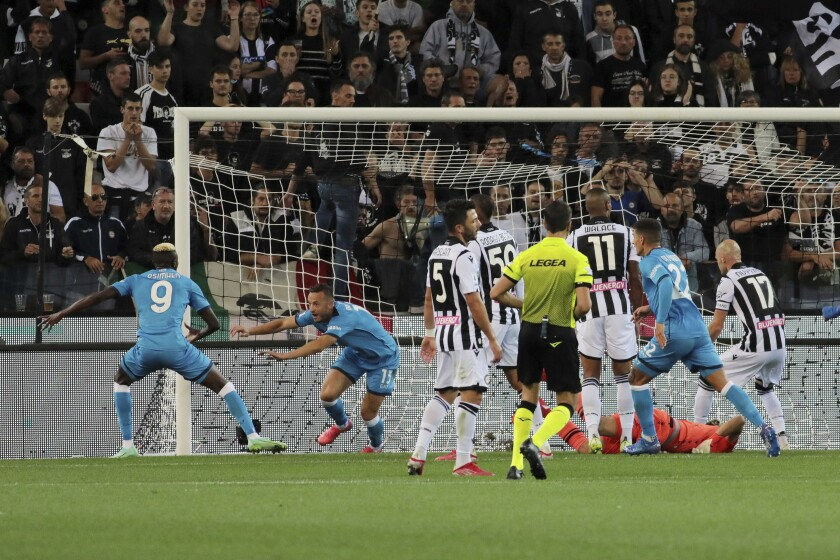 Napoli's Amir Rrahmani scores his side's second goal of the game during the Serie A soccer match between Udinese and Napoli, at the Dacia arena in Udine, Italy, Monday, Sept. 20, 2021. (Andrea Bressanutti/LaPresse via AP)
