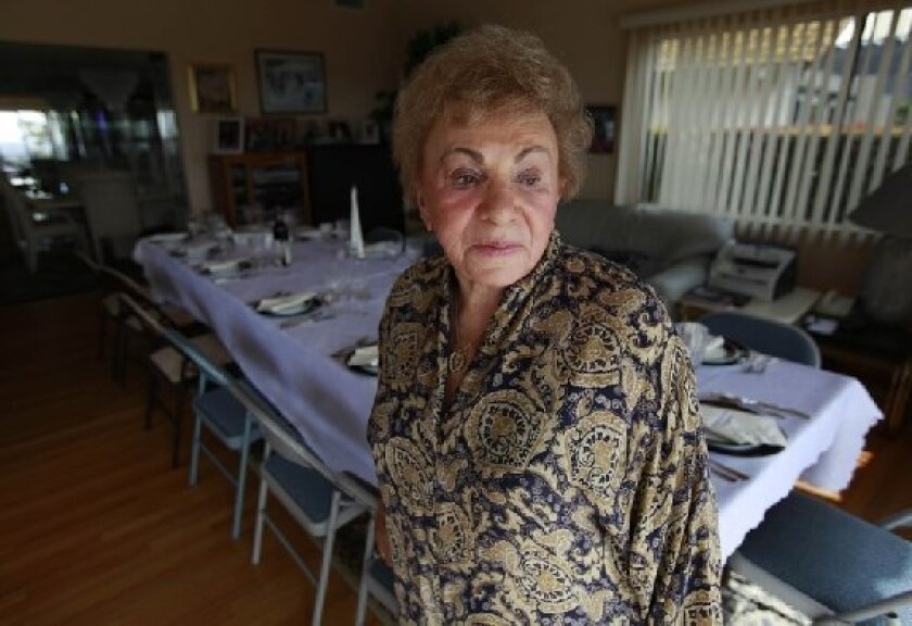 Gussie Zaks, 83, whose Del Cerro home was set for Passover, survived Nazi  death camps.