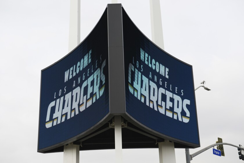 A sign is illuminated outside of The Forum to welcome the Los Angeles Chargers prior to their rally in Inglewood.