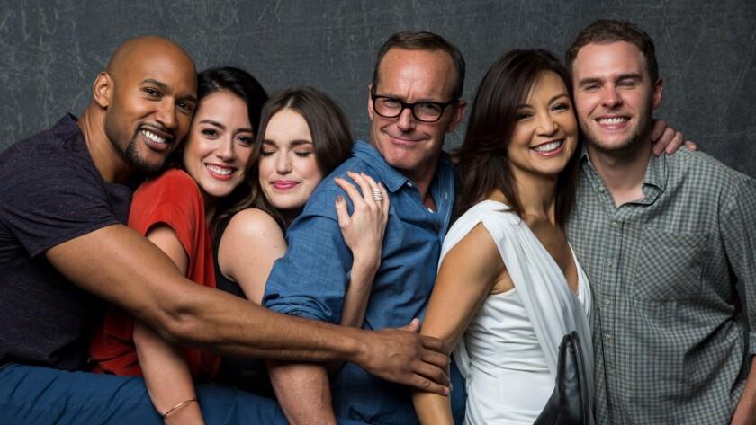 """Henry Simmons, left, Chloe Bennet, Elizabeth Henstridge, Clark Gregg, Ming-Na Wen and Iain De Caestecker of """"Marvel's Agents of S.H.I.E.L.D."""""""