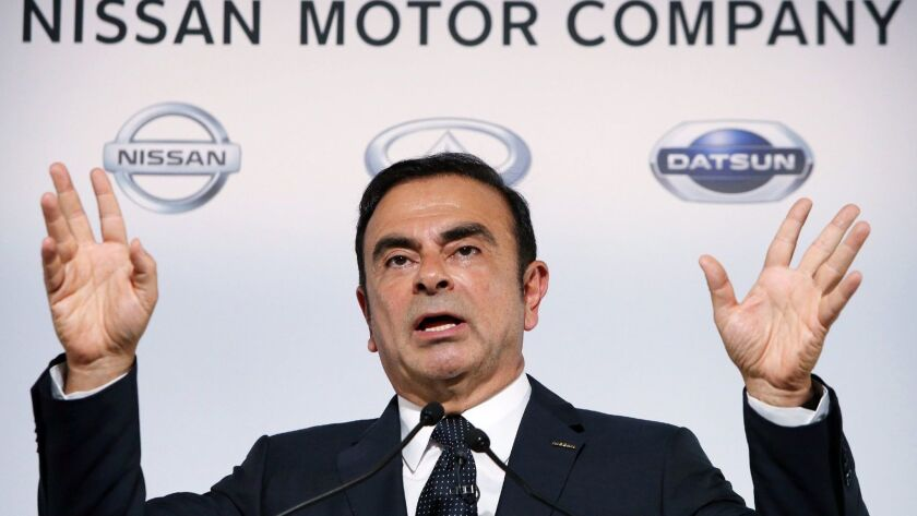 In this photo taken on Nov. 1, 2013, Carlos Ghosn, then president of Japan's auto giant Nissan Motor Co., announces the company's first-half financial results at the automaker's headquarters in Yokohama, suburban Tokyo.