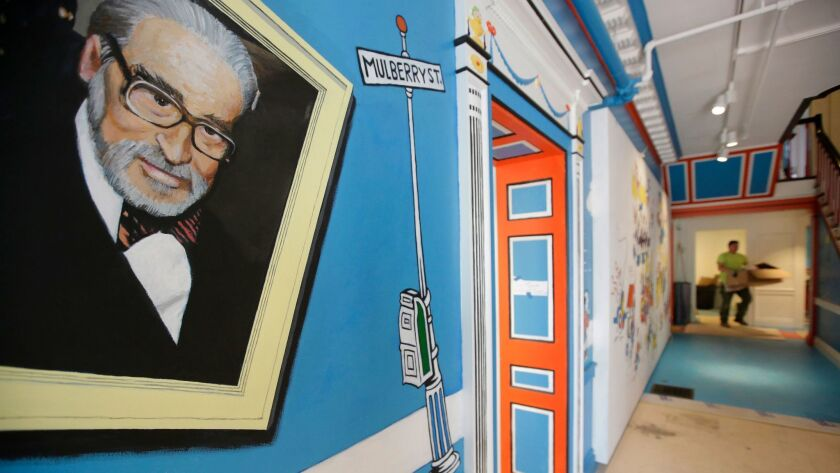 In this May 4, 2017, photo a mural that features Theodor Seuss Geisel, left, also know by his pen na