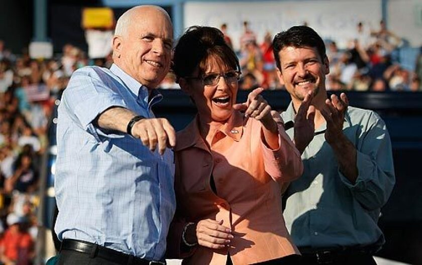 Republican presidential candidate Sen. John McCain of Arizona, left, his newly minted running mate, Alaska Gov. Sarah Palin, and her husband, Todd, greet supporters during a campaign event at Consol Energy Park in Washington, Pa. More photos >>>