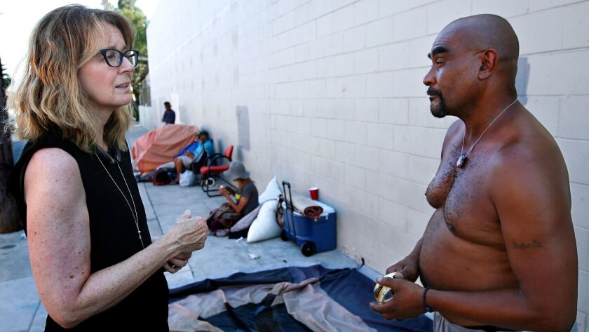 Kerry Morrison talks to Keith Weston, 52, at a homeless encampment on El Centro Avenue in Hollywood.