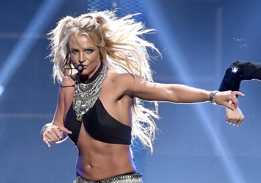 Britney Spears, hair flying, performs onstage