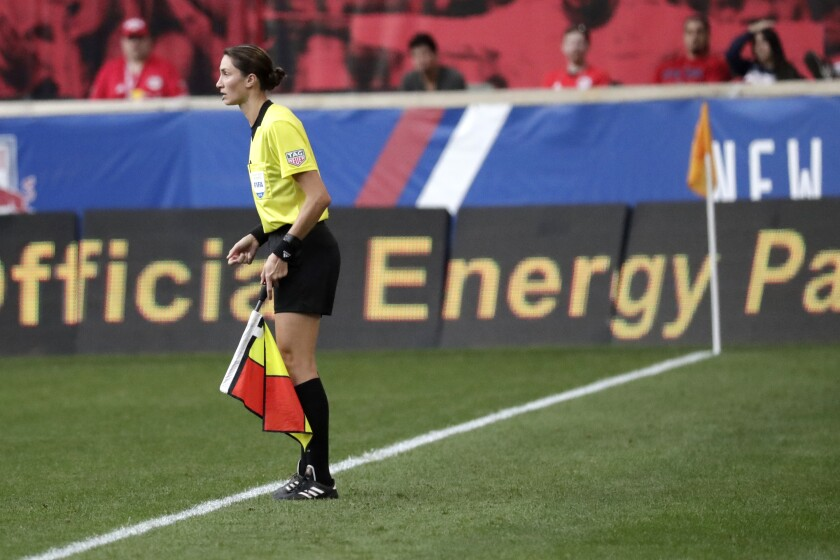 FILE - In this Sept. 22, 2018, file photo, official Kathryn Nesbitt watches during the first half of an MLS soccer match between the New York Red Bulls and Toronto FC in Harrison, N.J. When the Portland Timbers play Orlando City in the MLS is Back tournament championship on Tuesday night, Aug. 11, assistant referee Nesbitt will become the first woman to work a Major League Soccer title game. Nesbitt and Felisha Mariscal are the only two women among more than 40 officials that have been sequestered — just like the teams — in Florida for the monthlong tournament. (AP Photo/Julio Cortez, File)