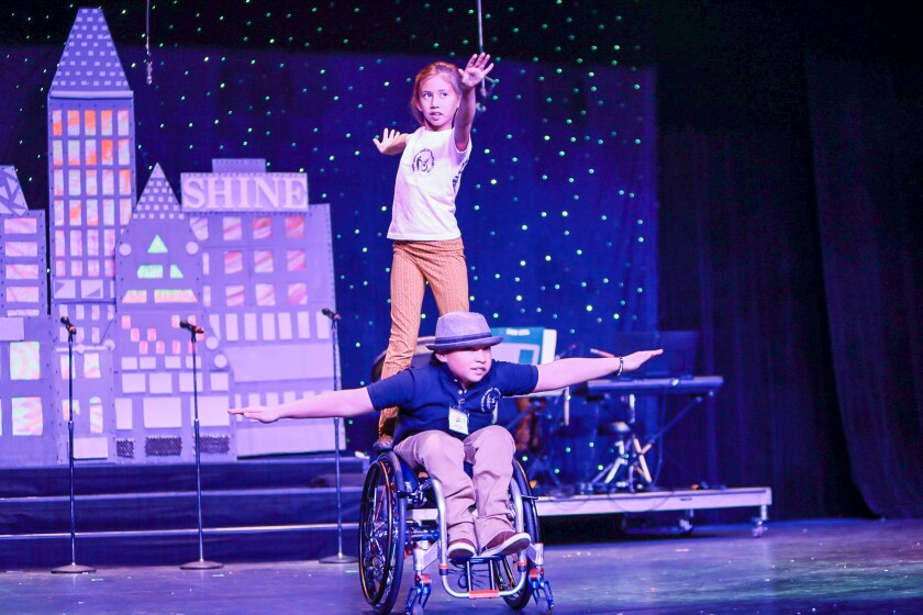 """Gracie (top) and Angelo Sanchez of Wheelchair Dancers Organization perform in """"Shine."""""""