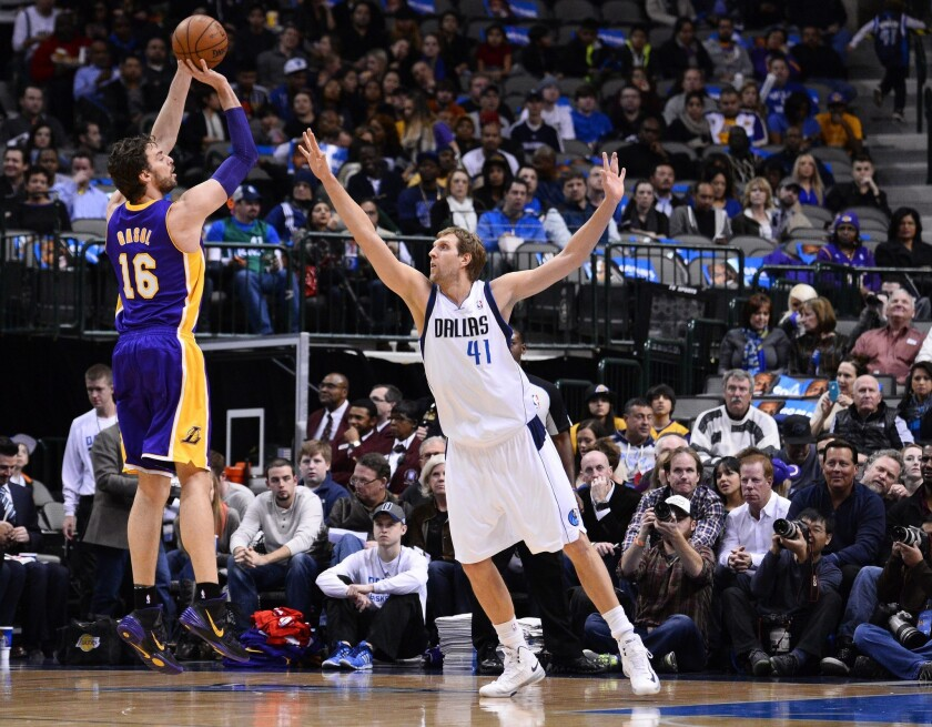Lakers center Pau Gasol shoots over Dallas Mavericks forward Dirk Nowitzki.