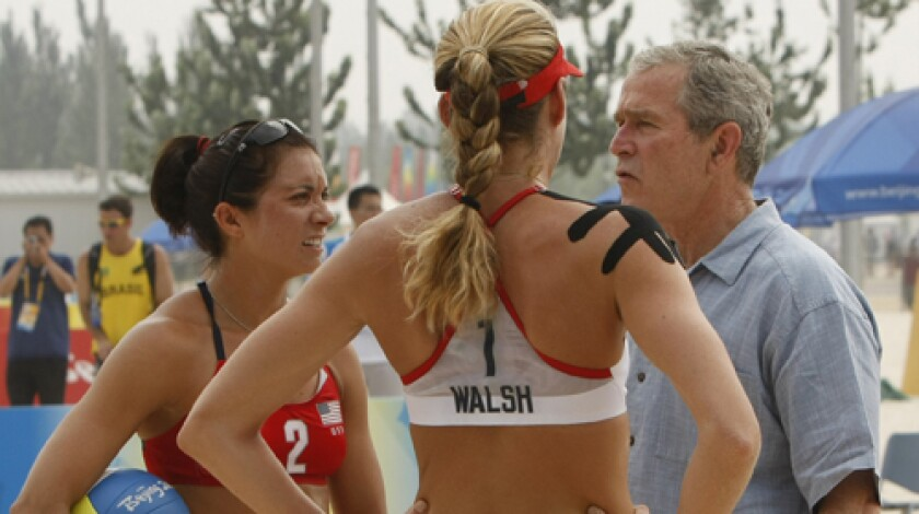 SAND MAN: A shirt-sleeved President Bush gives volleyballers Misty May-Treanor and Kerri Walsh some props.