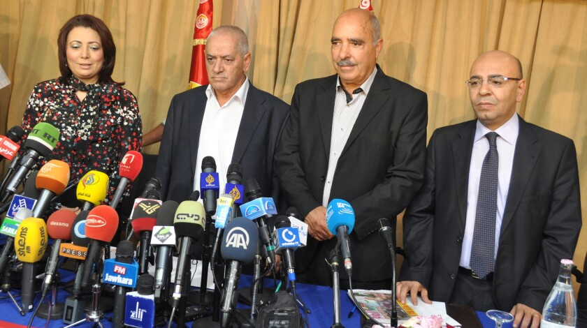 Representatives of the groups that make up the Tunisian National Dialogue Quartet discuss being awarded the Nobel Peace Prize in Tunis, Tunisia, on Oct. 9.