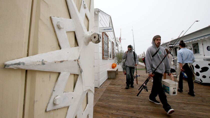 Fishermen walk on the pier in Malibu, which last week became a sanctuary city.