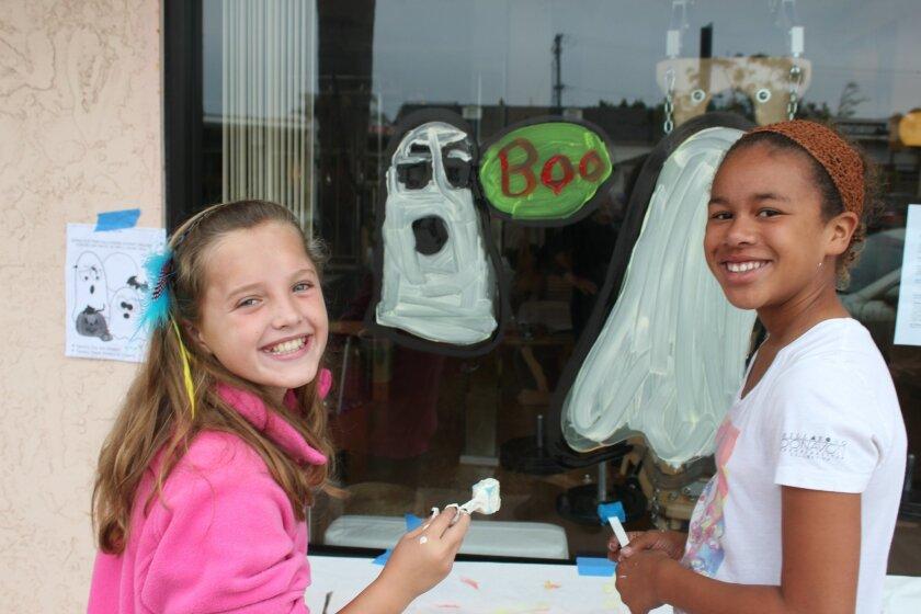 2) Jenna Torbensen, left, and Nan Pieper handpaint ghosts
