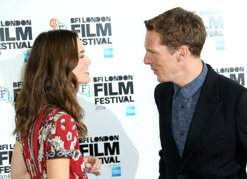British actors Benedict Cumberbatch and Keira Knightley greet one another before they pose for photographers during the photo call of the film The Imitation Game, at the Corinthia Hotel in central London, which will open the London Film Festival, Wednesday, Oct. 8, 2014. (Photo by Joel Ryan/Invision/AP)
