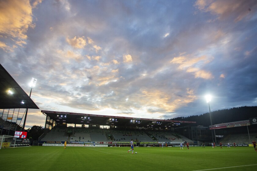 A colourful evening sky can be seen during a German Bundesliga soccer match between SC Freiburg and Hertha BSC Berlin in Freiburg , Germany, Tuesday, June 16, 2020. (Tom Weller/Pool via AP)